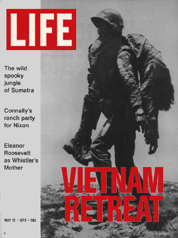 VIETNAM SOLDIER CARRIES WOUNDED BUDDY
