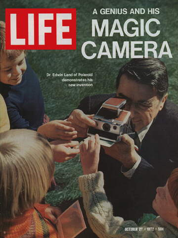 DR. EDWIN LAND WITH CAMERA